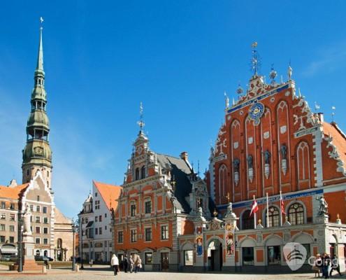 Latvia_Riga_ Blackhead's house_Saint Peters church_shutterstock_1368639351